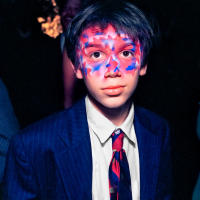 Young boy with painted face, New York City  © 2017 Keith Trumbo